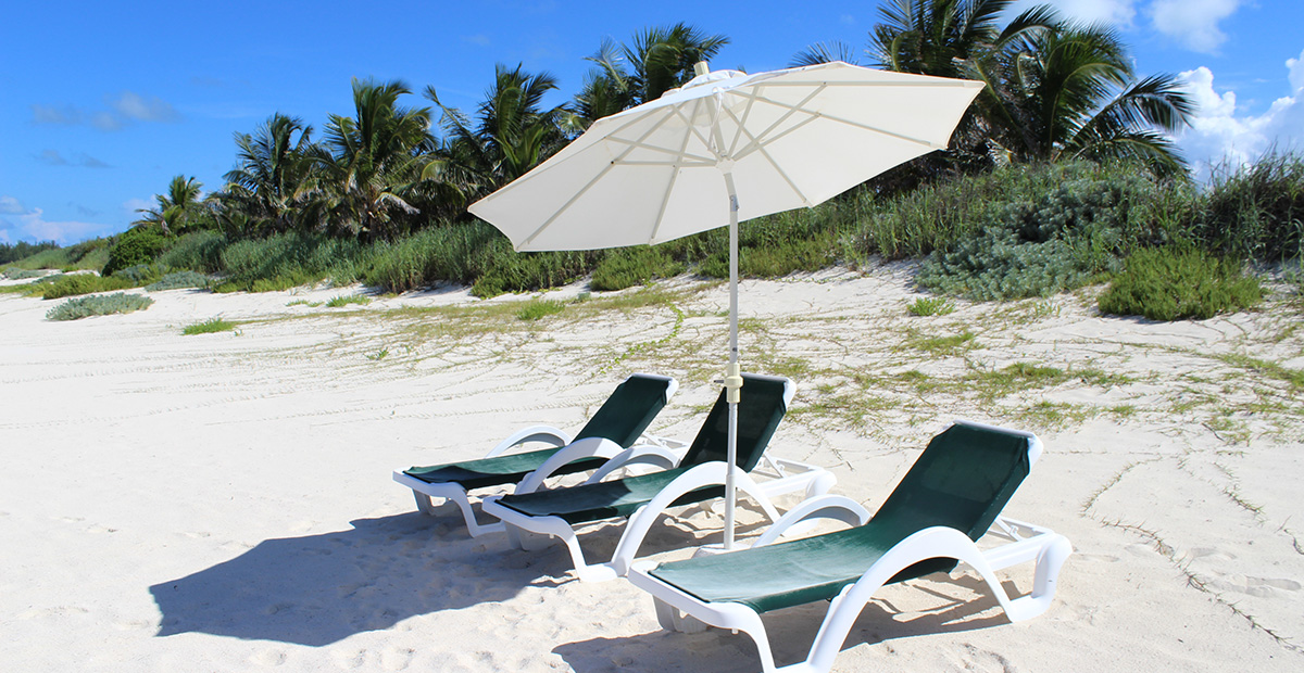 Private lounge chairs on the beach of Orchid Bay